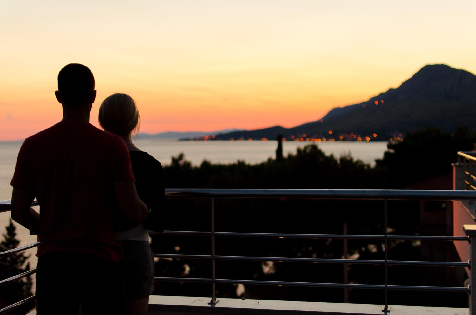 Couple overlooking sunset