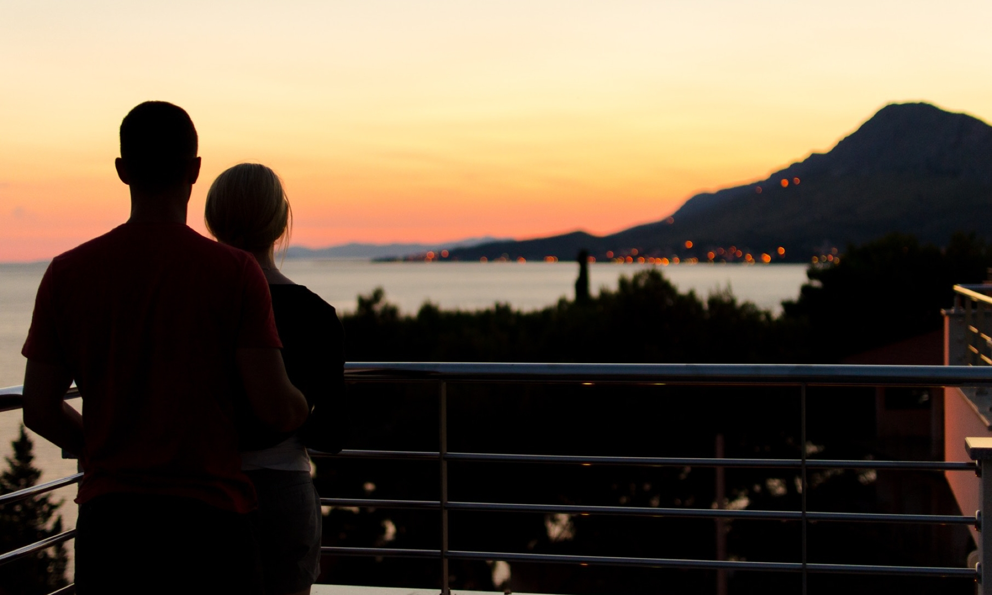 Couple overlooking sunset